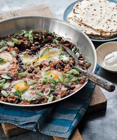 Skillet-Poached Huevos Rancheros | Thanks to these easy, healthy dinner recipes, you can solve the mystery of what to make tonight (and all those busy nights to come).