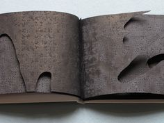 MAX MAREK Carnet Noir (Little Black Book), 2011 Braille paper dyed black with series of overlapping cutout fingers; cover is white leather, slipcase 5.5 x 9 x .5 inches. $500