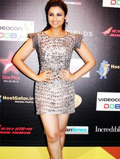 Parineeti Chopra is seen In a short shimmery silver dress, Parineeti looks pretty neat for an even as big as the IIFA.