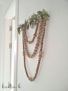 Boho Nordic Wooden Bead Wall Hanging is part of Wooden bead garland - Using wooden beads a string and little more, make this beautiful boho nordic wooden bead wall hanging in no time! Wood Bead Garland, Beaded Garland, Diy Garland, Home Crafts, Diy Crafts, Fall Crafts, Boho Diy, Bohemian, Hobbies And Crafts