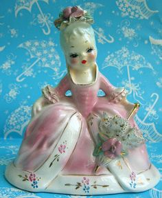 Marie Antoinette Figurine - I love this beauty.  She sits regally upon my side table.