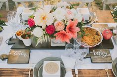 Pretty centerpiece + personalized wooden cutting boards for guests