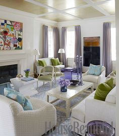 """""""Cocktail tables can define different seating arrangements more than the seating,"""" Healing says. All three in this area of the living room are from HB Home, as is the rug, which unifies the areas. Green occasional chairs are easily moved around. Curtains are J. Robert Scott's Puckered Diamond; the ceiling is papered in Metallic Leaf by Phillip Jeffries. Maura McEvoy  - HouseBeautiful.com"""