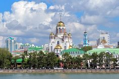 View of the Church on Blood, the Church of Christ's Ascension and the Patriarch's Metochion from the city pond of Yekaterinburg, Russia
