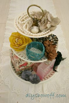 thrift store tiered candy dish to hold accessories (or DIY one with plates, candlesticks and glue)