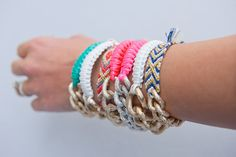 I could totally make these myself!  Makes me very nostalgic for DMC floss and gimp and OP bracelets :)