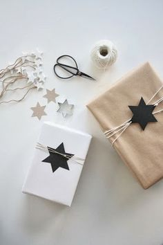Add  string to a gift wrapped in plain paper and add a graphic punch with a stamped shape or painted wooden shape #giftwrap