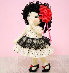 This is a finished handmade amigurumi crochet doll of a sweet doll called Simone created by @petite_tini (Instagram). Simone is an elegant girl who loves all things in classic black and white. She has on a handmade black and white polka dot dress that is edged with black lace. She