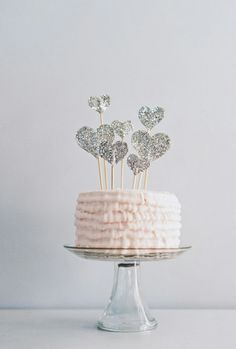 pale pink frosting + silvery glitter heart candles = perfect birthday cake combo