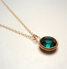 Vintage Swarovski emerald green round crystal glass pendant charm on gold fill chain necklace.