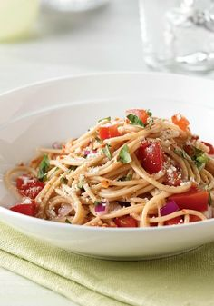 No-Cook Fresh Tomato Sauce with Pasta -- In this Healthy Living recipe, the combination of juicy sweetness blended with fresh basil is an Italian classic and a refreshingly smart warm-weather choice.