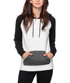 A black hood and raglan sleeves along with a charcoal pocket contrast the white body for a trendy two-tone look, with the added comfort of the soft fleece construction.