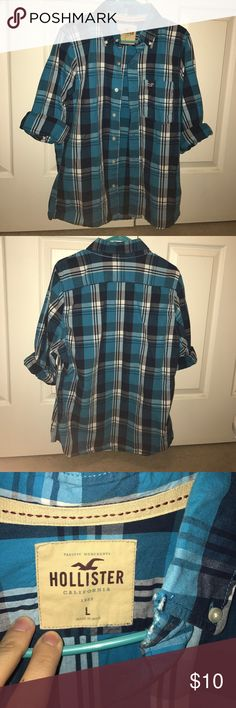 Blue plaid men's button down! Blue plaid men's button down, it has a little mark on the collar which you can see in the pictures. Hollister Shirts Casual Button Down Shirts