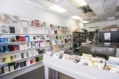 Art Metropole, the venerable artist-run centre and retailer, has settled in nicely after moving from King Street to cozier digs near Dundas and Dufferin . Toronto, Art Gallery, Photo Wall, Galleries, Centre, June, Packing, Posters, Furniture