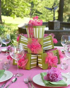 """Wrapped then stacked, these gifts make a perfect centerpiece for a birthday party (adjust for colors - """"Black and Bling,"""" """"Denim and Diamonds,"""" or """"Dimes and Diamonds,"""" and maybe have something inside each box as a door prize/giveaway?)"""