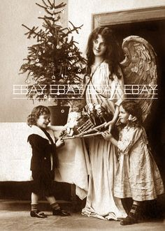 Early 1900's Christmas Tree and Angel with Children Dolls Toys Doll Photo | eBay Doll Toys, Dolls, Vintage Christmas Photos, Photo Search, Child Doll, Little Girls, Christmas Tree, Angel, Couple Photos