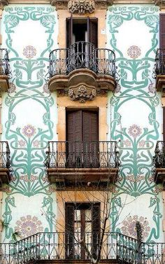 Beautiful facade in Barcelona, Spain. Balconies with intricate tile designs on the walls surrounding them. You can find so much beauty for your eyes in Barcelona, the city is full of unusual and captivating architecture. Architecture Art Nouveau, Architecture Details, Barcelona Architecture, Art Deco, Beautiful Buildings, Beautiful Places, Art Nouveau Arquitectura, Windows And Doors, The Places Youll Go