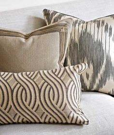 Old Digs, New Threads Living room pillows feature a Threads viscose-and-linen undulating stripe, a solid linen with braid, and a silk Ikat.