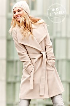 A wide lapel and a slightly flared silhouette add a bit of drama to this mid-length wool coat. / The Belted Wrap Coat