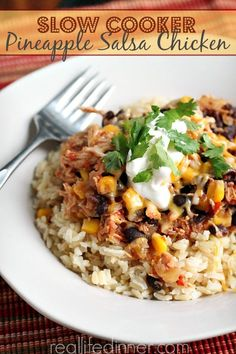 Slow Cooker Pineapple Salsa Chicken aka Mexican Delight..you are about to be your families hero. This Healthy Recipe is DELICIOUS!!!   reallifedinnner.com