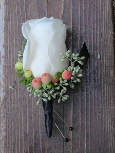 This would be a classic look for boutonnieres however, we added some elements with a twist.