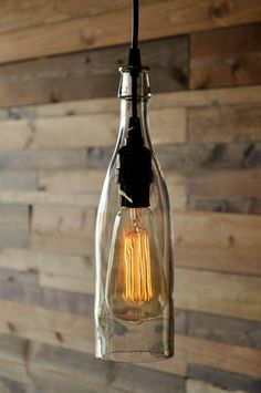 Clear Wine Bottle Hanging Pendant Lamp - Recycled Glass Bottle - Bottle Light - Farmhouse Light - Modern Rustic Decor - Vintage Style Bulb - This is a clear Wine bottle thats been cut by hand, polished and wired for hanging as a pendant lam -