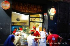 standing outside a pizzeria in Naples and a nun walks past