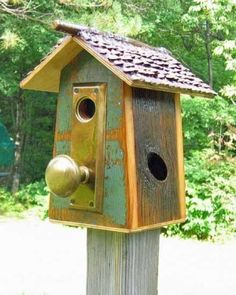Door knob birdhouse!  Could anything be cuter?!  Gather up a few materials and I bet you could make something similar to this in a pinch.  garden decor. bird houses.  unique bird houses. door knobs. gardening.