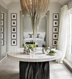 ENTRYWAY IDEAS FOR YOUR HOME | round table and a great chandelier make the perfect statement entryway | bocadolobo.com/ #modernentryway #entrywayideas