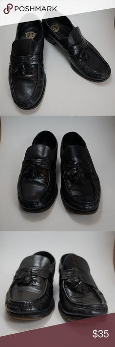 Florsheim black leather tassel slip on loafer 8 Very gently used The Florsheim shoe loafer. All black leather exterior. Tassel toe details. Stretch over top of foot beneath tongue. Wear to soles as shown. Minor scuffs and wear to exterior. In great condition and very comfortable. Size 8. Florsheim Shoes Loafers & Slip-Ons