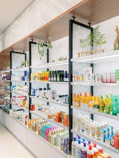 We gathered inspiration from nature and the foliage found in a medical herb garden for this pharmacy. Pharmacy Store, Pharmacy Humor, Cubicle Design, Counter Design, Cosmetic Shop, Clinic Design, Retail Store Design, Store Interiors, Retail Interior