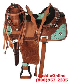 This absolutely unique and stunning saddle will impress everyone! The underneath of the saddle has a premium, thick fleece that is heavily padded for the horse's comfort. The black suede, padded seat features a star pattern with ostrich print. You'll be sure to shine with the blue crystals and Texas star conchos. Model 2934. ONLY $499.99