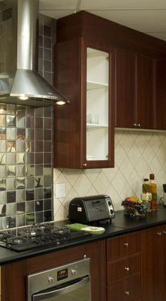 For a glamorous look, use metallic mosaic tiles to create a splash-back in your kitchen Feature Walls, Trendy Home, Mosaic Tiles, Floors, Kitchens, Kitchen Cabinets, Metallic, Houses, Bathroom