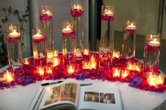 Decor for the guest book table with red and purple color theme