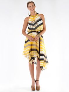 Show off toned shoulders in this geometric stunner. The asymmetrical hem allows you to also reveal a peep of leg, while still being long enough for you to comfortably sit and dine with guests