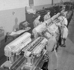 Female workers attach the Induction Manifolds to the Cylinder Blocks, prior to the Blocks being fitted to the engine, at this aircraft engine factory somewhere in Britain. Aircraft Engine, Ww2 Aircraft, Military Aircraft, Rolls Royce Engines, Rolls Royce Merlin, The Spitfires, Supermarine Spitfire, Ww2 Planes, Battle Of Britain