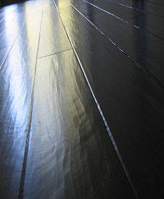 black handscraped wood flooring in my office will look tres chic