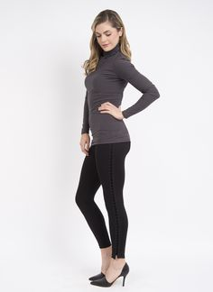 Classic legging with a modern twist. FIT: Full-length legging designed with LysséFit, our signature, hidden hi-waist and soft stretch lining for the right amount of control & refined fit. FABRIC: Crafted in ponte, a custom blended fabric that offers a soft hand, extreme comfort and holds its shape with no bagging or sagging. Machine wash, line dry. FASHION: Side of legging is adorned with a striking lace up, featuring a shiny satin finished cord providing this legging with edge.