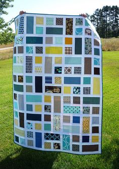 Am I ready to get into quilting? squares and rectangles. I like the simplicity of this quilt and the modern look.