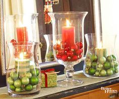 Use any size Hurricane & fill with dollar store ornaments, candy ect. layer for a bigger statement & they're ready to go on a mantel or floor just behind your photos :)