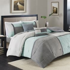 Urban Hues 5 Piece Set is the perfect comforter collection if you're looking for something that fits your casual lifestyle. The comforter and shams feature cool colors of aqua, grey, and charcoal that are pieced together to form a colorblock pattern. The comforter and shams reverse to a solid grey color in microfiber. Two embroidered and pieced decorative pillows are included in the set to give a added dimension and a cohesive look.