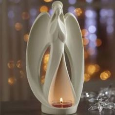 "$18 infinity angel tealight holder - A sculptural, fluid display of beauty and grace. Our bisque ceramic angel holds a tealight, sold separately, in her flowing gown. 9"" h, 5"" w. by #PartyLite #Candles"