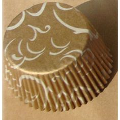 Luscious gold color adds elegance to your muffins and cupcakes. This uniquely elegant cupcake liner is perfect for special celebrations. Gold background has subtle white accent design, regular size cupcake liner, 2 wide on bottom and 1-3/8 deep and greaseproof. Approx. 60 cups/pkg.