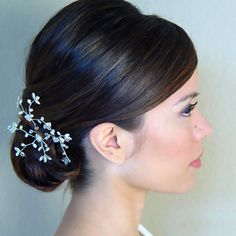 Make the Typical Side Bun More Romantic for Your Wedding Hairstyle