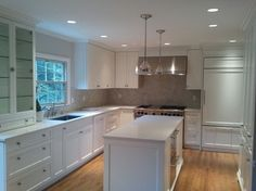 "Frosty Carina+Sonoma Tile ""Bossy Grey"" 2x8 with BM Simply White Cabinets."