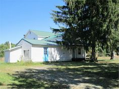 Spacious 5 bedroom home on 28 acres. Most of the house redone in 2005. Large utility room on first floor. Gravity fed water to house and barn. The barn/shop is 24 x 50 with a concrete floor. 3 acres fenced pasture & approximately 20 wooded acres. No electric service to house, outhouse only. Mineral Rights will transfer. Wood stoves do not stay. Great off the grid opportunity!