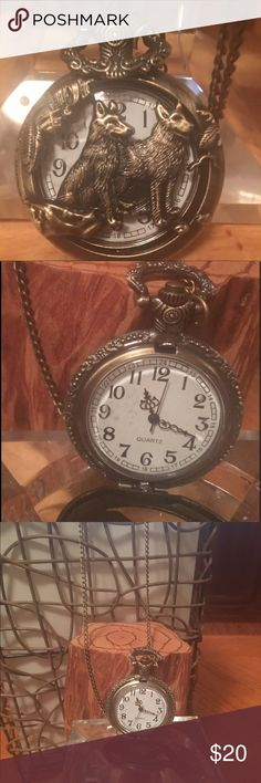 Pocket Watch, necklace chain (16in). Pocket Watch, in old world Bronze metal, back is beautiful etched with leafs back (shown in pictures)  Does not have brand name ??, only word indicated is Quartz.  IS WORKING,  glass perfect, I put plastic over the glass to protect.  I think Two Wolf's (or even could be 2 dogs).   NICE WATCH Jewelry