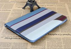 Smart cover case with dormancy and wake-up function, with a handband to secure your device, with a stand on back cover, quality luxury high fashion design.