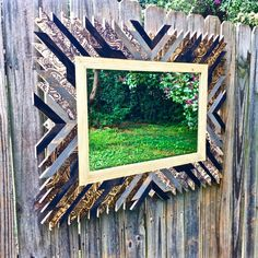 This piece is a combination of both new and reclaimed wood. The salvaged materials have either been stained or left in their original state, while