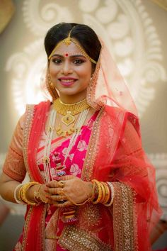 South Indian Bride - Bride in a Pink and Orange Outfit with Gold Jewelry Indian Wedding Poses, Indian Bridal Photos, Bengali Wedding, Bengali Bride, Saree Wedding, Malayali Bride, Bridal Bangles, Bridal Jewelry, Or Mat